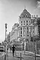 Black and white view of the historic and famous Hotel Negresco taken from the Promenade des Anglais, Nice, France.