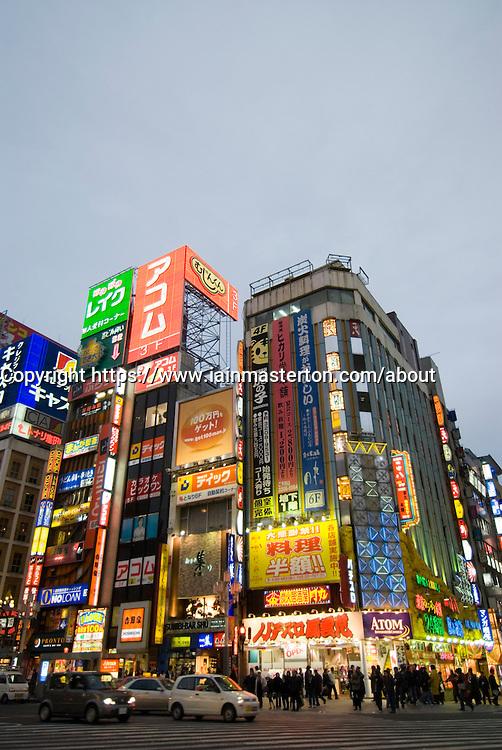 Evening view of many illuminated signs on building in Kabuki Cho entertainment district of Shinjuku Tokyo Japan