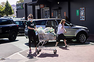Customers with full trolleys outside Woolworths in Mitcham. New COVID Lockdown Restrictions announced today by the SA Premier Steven Marshall caused panic shopping at supermarkets as people stocked up with essential groceries.   (Photo by Peter Mundy/Speed Media)