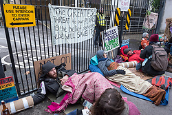 © Licensed to London News Pictures. 21/12/2018. Bristol, UK. 'Extinction Rebellion' campaigners block the side entrance and car park at the BBC Bristol offices in Whiteladies Road after three campaigners locked themselves together blocking the main entrance while others sang modified christmas carols on the shortest day just before Christmas to draw attention to the catastrophic impact of climate change. Campaigners later left peacefully without arrest. The Extinction Rebellion campaign says there will be mass actions outside the main BBC headquarters in London, Manchester, Norwich and Bristol to bring to light what they say is the utter failure of the BBC to fulfill their most fundamental duty to educate and inform the British public on the most important issue of our time, the climate crisis.<br /> Extinction Rebellion say the BBC must lead from the front on the climate emergency and make these demands: 1: The BBC Director General Tony Hall to agree to a meeting with a delegation from Extinction Rebellion to discuss how the corporation can meet its crucial moral duty to tell the full truth on the climate and ecological emergency. 2: The BBC to declare a climate and ecological emergency that we need to act now, the extinction of the natural world is happening and we face the collapse of our civilisations.3: That the BBC place the climate and ecological emergency as its top editorial and corporate priority - integrated into all of aspects of the BBC's output, not just environmental sections - by adoption of a climate emergency strategic plan, at the level of urgency the corporation placed on informing the public about World War 2. 4: The BBC to divest all pension funds, investments and bank accounts from fossil fuel corporations and their bankers. 5: The BBC, its subsidiaries and its supply chain to agree to be zero-carbon by 2025. 6: The BBC to publish an annual eco-audit of all BBC operations, including summary of key ecological and carbon data. 7: The BBC to take a