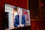 On a tv in a living room in Moseley Prime Minister Boris Johnson announces a new national coronavirus lockdown during a live television address on 4th January 2021 in Birmingham, United Kingdom. Following the recent surge in cases including the new variant of Covid-19, this nationwide lockdown, which is an effective Tier Five, will come into operation on 6th January, with all citizens to follow the message to stay at home to save lives.
