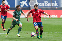 Iker Muniain of Athletic Club competes for the ball with De Las Cuevas of Club Atletico Osasuna during the match of  La Liga between Club Atletico Osasuna and Athletic Club Bilbao at El Sadar Stadium  in Pamplona, Spain. April 01, 2017. (ALTERPHOTOS / Rodrigo Jimenez)