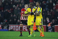 Football - 2018 / 2019 Premier League - Southampton vs. Crystal Palace<br /> <br /> Jordan Ayew of Crystal Palace and Southampton's Oriol Romeu pull Wilfried Zaha of Crystal Palace away from Referee Mr Andre Marriner after the palace player received a red card for sarcastically applauding his yellow card at St Mary's Stadium Southampton<br /> <br /> COLORSPORT/SHAUN BOGGUST