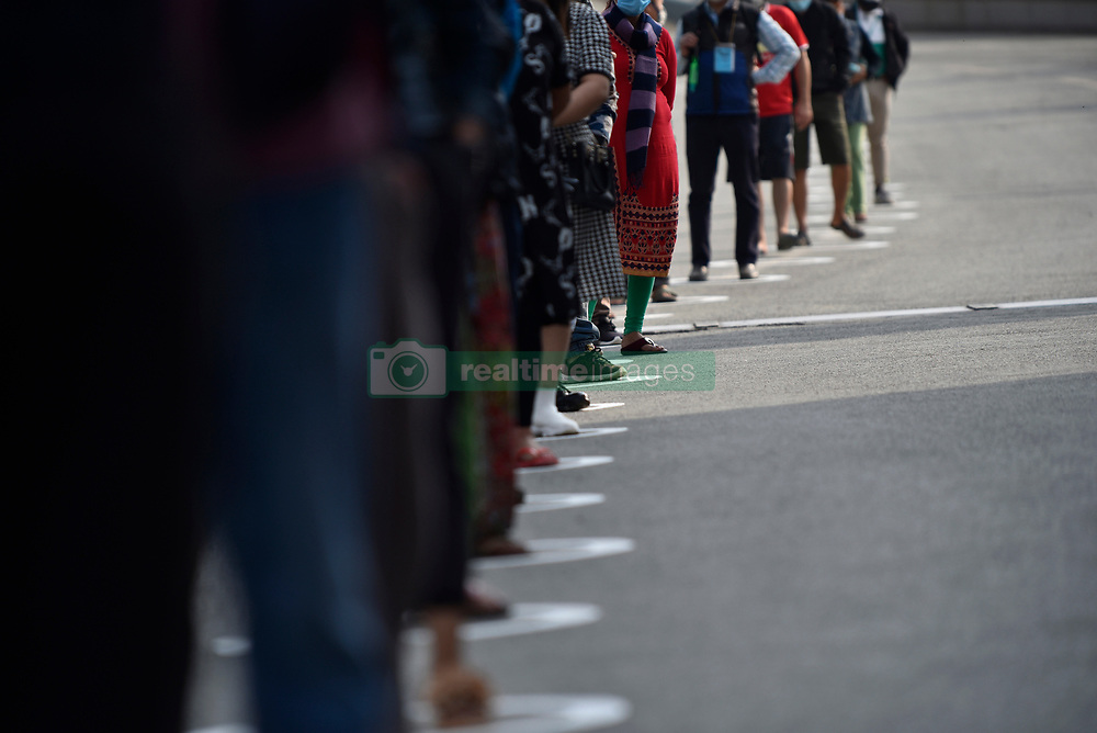 April 17, 2020, Kathmandu, NP, Nepal: Shoppers in white circle obeyed 1.5-meter social distancing, while queuing to buy food during lockdown as concerns about the spread of Corona Virus (COVID-19) in Bhat Bhateni Supermarket in Kathmandu, Nepal on Friday, April 17, 2020. (Credit Image: © Narayan Maharjan/NurPhoto via ZUMA Press)