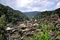 September 14, 2016 - China - Guizhou, CHINA-September 1 2016: (EDITORIAL USE ONLY. CHINA OUT) ..Traditional village of Dong minority group in Congjiang County, southwest China¬°¬Øs Guizhou Province. Dong ethnic minority people are traditionally live on rice with skilled cultivating on famous terraces. It is also an ethnic group skilled in wooden architectures with no nails. The unique wooden architectures of inhabited houses and drum towers are the main features of Dong Minority. A typical Dong house is a three-storey one built on wood pillars; people live in the second floor, and the third floor is used as a storage for food while the first floor is reserved for animals and firewood. (Credit Image: © SIPA Asia via ZUMA Wire)