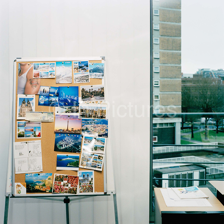 Postcards  from around the world juxtaposed with a typically grey view from a Leeds office window . From the series Desk Job, a project which explores globalisation through office life around the World.