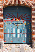 Traditional painted door frontage in medieval Ribe centre in South Jutland, Denmark