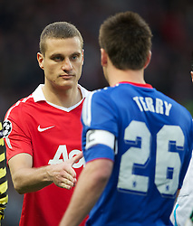12.04.2011, Old Trafford, Manchaster, ENG, UEFA Champions league, viertel Finale, Manchester United FC v Chelsea FC, im Bild Manchester United's captain Nemanja Vidic and Chelsea's John Terry shake hands before the UEFA Champions League Quarter-Final 2nd Leg match at Old Trafford. EXPA Pictures © 2011, PhotoCredit: EXPA/ Propaganda/ David Rawcliffe +++++ ATTENTION - OUT OF ENGLAND/UK +++++