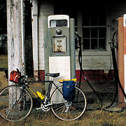 """""""No Gas"""" - Loaded touring bicycle at abandoned gas station. Bike-tography by Martha Retallick."""