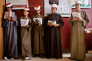 Schoolboys learn verses from the Koran during a religious class in a classroom at the Islamic Koom al-Bourit Institute for Boys in the village of Qum (Koom), on the West Bank of Luxor, Nile Valley, Egypt.