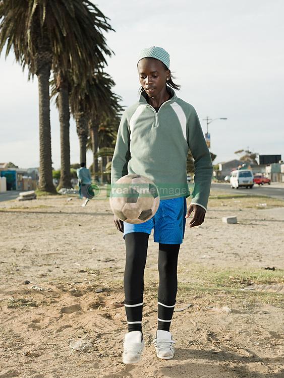 Jul. 26, 2012 - Boy playing keepy uppy (Credit Image: © Image Source/ZUMAPRESS.com)