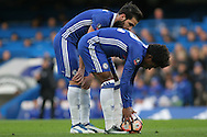 Willian of Chelsea prepares to take a free kick as his teammate Cesc Fabregas offers advice, Willian scores from the free-kick. The Emirates FA Cup 4th round match, Chelsea v Brentford at Stamford Bridge in London on Saturday 28th January 2017.<br /> pic by Steffan Bowen, Andrew Orchard sports photography.
