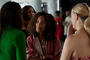 """Mara Brock Akil, creator and executive producer of  BET's """"Being Mary Jane"""", speaks with guests before a screening at the W Hotel in Dallas, Texas on June 22, 2013."""