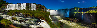 Panoramic view of Iguazu Falls (Iguacu in Portugese), on the border of Brazil and Argentina. It is one of the New 7 Wonders of Nature and is a UNESCO World Heritage Site. There are 275 waterfalls total which make up the largest waterfalls in the world. This photo is on the Brazil side of the Falls.