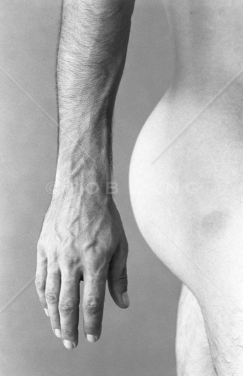 side view of man's buttocks, arm and hand