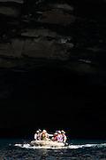 Tourists exploring Isabella Island coast by Zodiac Craft, Galapagos Islands.
