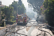 Trucks from Los Angeles Fire Department came to the two houses caught on fire on Casiano Road in Bel Air in Los Angeles, California. Firefighters arrived there at 4am, and they fights for straight over 10 hours. On Wednesday, December 6th, 2017. (Photo by Yuki Iwamura)
