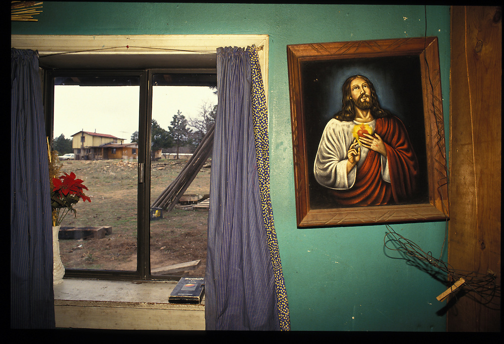 Although he aspires to become a medicine man, Sawmill resident Kenneth Begay does not mind that other family members practice Christianty.  A picture of Christ inside his home attest to his flexible beliefs.