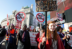 © licensed to London News Pictures. London, UK 03/03/2012. A teenager girl carries a placard which has naked women pictures cut from tabloid newspapers as women marching at Million Women Rise march against male violence and rape in London, this afternoon (03/03/12). Photo credit: Tolga Akmen/LNP