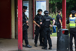 "Kensal Green, London, May 31st 2016. Police in body armoured protective headgear seal off Kensal Green tube station in North West London in what is described as a ""security incident"". PICTURED: Armed officers outside the station entrance."