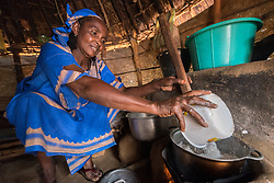 4 June 2019, Meiganga, Cameroon: Ndjobdi Hawaou from Nyem Yelwa in CAR, cooks the traditional Cassava flour-based meal Nyiri, on a newly made stove. Trained by the Lutheran World Federation, women in the Ngam refugee camp build stoves that retain heat better, and which ensure less firewood is needed in order to cook a meal. Supported by the Lutheran World Federation, the Ngam refugee camp, located in the Meiganga municipality, Adamaoua region of Cameroon, hosts 7,228 refugees from the Central African Republic, across 2,088 households.