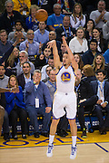 Golden State Warriors guard Klay Thompson (11) shoots a three pointer against the Indiana Pacers at Oracle Arena in Oakland, Calif., on December 5, 2016. (Stan Olszewski/Special to S.F. Examiner)