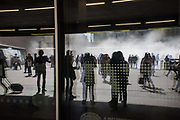 Reflection of the children and adults playing in the fog installation by Japanese artist Fujiko Nakaya outside Tate Modern. London. 12 April 2017