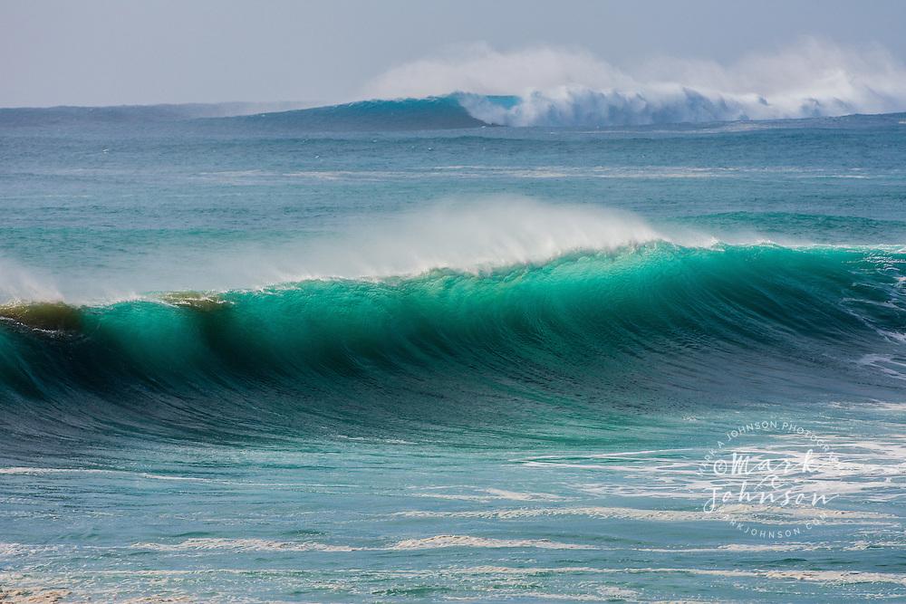 Huge wave breaking off of Oahu, Hawaii