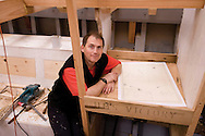 """Sailor and adventurer Pete Goss shown here at the chart table made from a beam from HMS Victory. ..The beam was milled into planks and the chart table made from this.With a slice of copper rivet from the ship which has been stamped for authenticity, inlaid into the table. Pete is building 37ft wooden lugger Spirit of Mystery to shine a light on the bravery of the seven Cornishmen who made the heroic journey to escape poverty and seek out a new life in Australia.. .All pictures must be credited """"Lloyd Images""""..For further info please contact Stuart Elford :+447796957677"""
