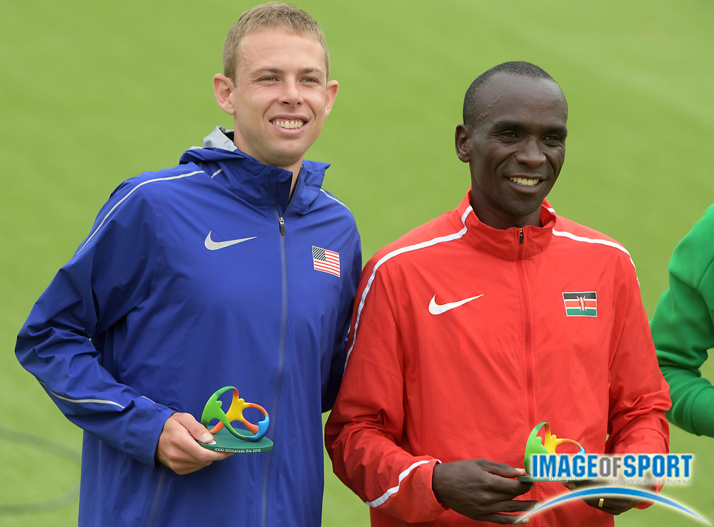 Aug 21, 2016; Rio de Janeiro, Brazil; Marathon winner Eliud Kipchoge (KEN), right, poses with third-place finisher Galen Rupp (USA) at the marathon during the Rio 2016 Summer Olympic Games at Sambodromo.