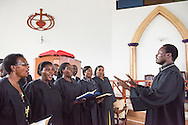 Lucas Mwigulu leads the choir during the graduation of 21 pastors and seven deaconesses on Saturday, March 14, 2015, at the Evangelical Lutheran Church in Tanzania – South-East of Lake Victoria Diocese's (ELCT-SELVD) Ebenezer Cathedral in Shinyanga, Tanzania.  LCMS Communications/Erik M. Lunsford