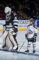 KELOWNA, CANADA - FEBRUARY 16: The Pepsi Save On Foods Player of the Game lines up with Michael Herringer #30 of Kelowna Rockets against the Red Deer Rebels on February 16, 2016 at Prospera Place in Kelowna, British Columbia, Canada.  (Photo by Marissa Baecker/Shoot the Breeze)  *** Local Caption *** Michael Herringer; Pepsi player;