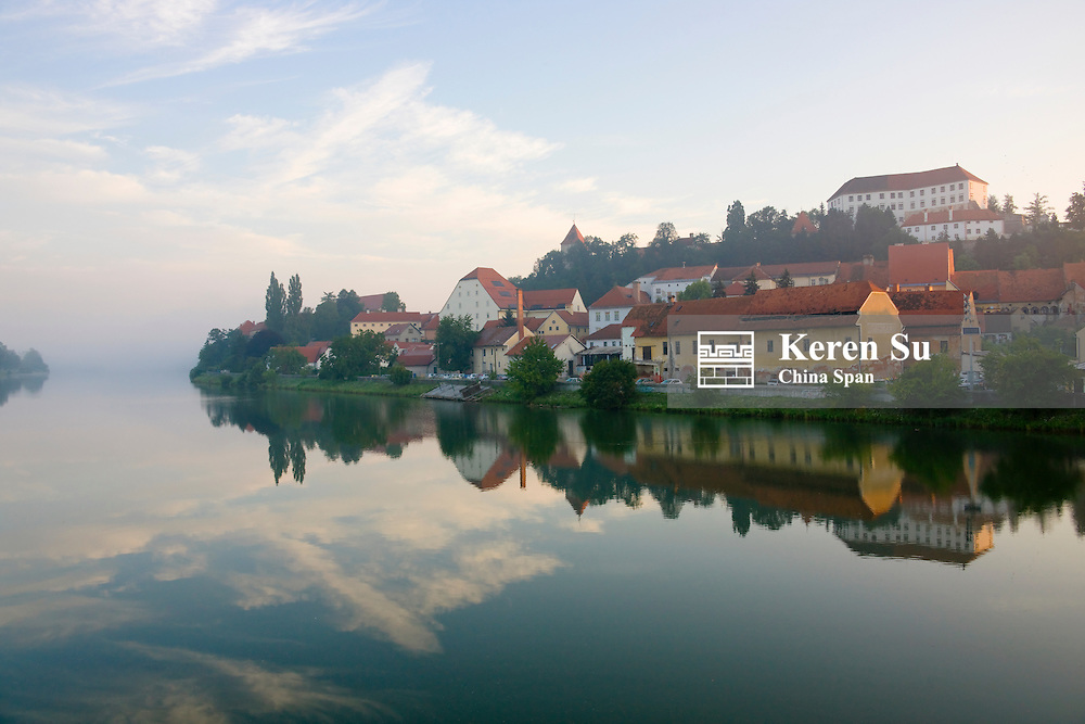 Morning view of Ptuj Castle and houses along Drava River, Ptuj, Slovenia