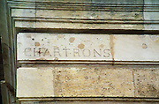 """An old street sign carved in stone on a building in Bordeaux: """"Chartrons"""" meaning Quai des Chartrons, which used to be the centre of the wine trade. Bordeaux City, Gironde Aquitaine France Europe"""