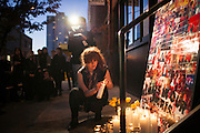 Laura Bond at a candlelight vigil for the Yellow Dogs, the band whose members were killed last week, at Cameo Gallery, 93 North 6th Street in the Williamsburg neighborhood of Brooklyn, NY on Monday, Nov. 18, 2013.<br /> <br /> Photograph by Andrew Hinderaker