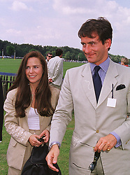 MISS KOO STARK and her former husband MR TIM JEFFERIES, at a polo match in Berkshire on 13th June 1999.MTD 137