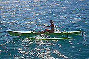Polynesian woman on outrigger canoe<br />