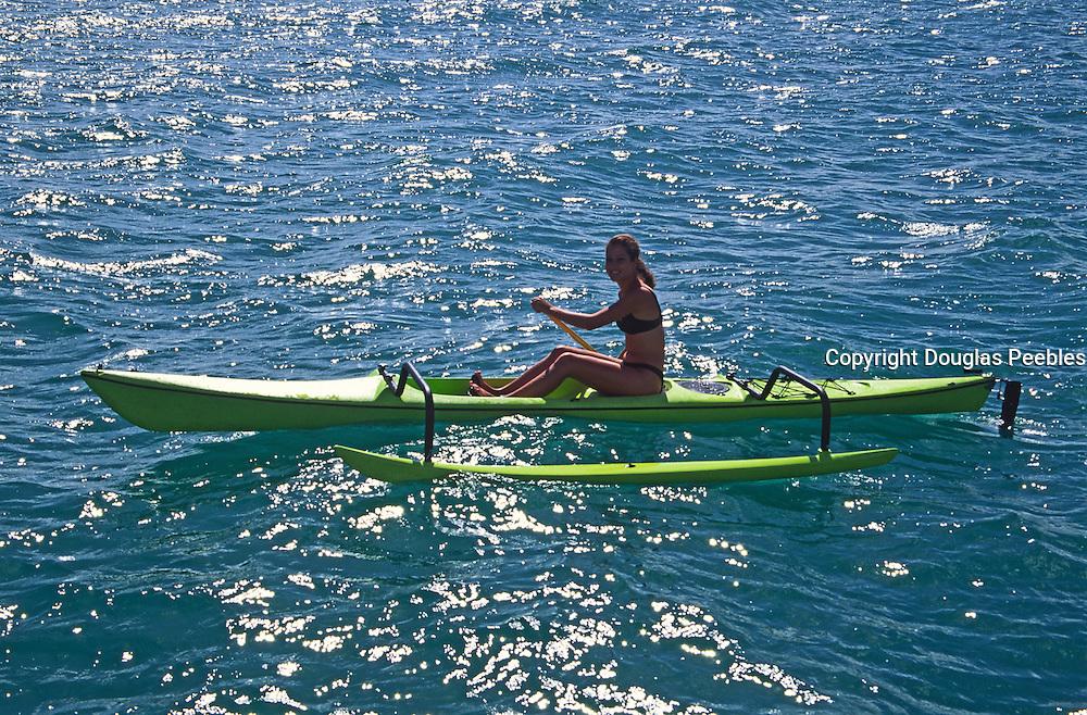 Polynesian woman on outrigger canoe<br />