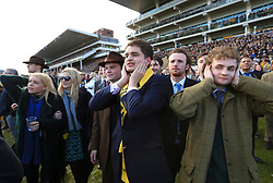 Racegoers react after their horse doesnt win the Ryanair Steeple Chase during St Patrick's Thursday of the 2018 Cheltenham Festival at Cheltenham Racecourse.