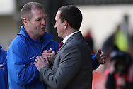 Scunthorpe manager Russ Wilcox (left) greets Newport County manager Justin Edinburgh. Skybet football league 2 match, Newport county v Scunthorpe Utd at Rodney Parade in Newport, South Wales on Saturday 1st March 2014.<br /> pic by Mark Hawkins, Andrew Orchard sports photography.