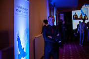"""A security guard during the conference inside """"Top Hotel"""" in Prague's quater Chodov. High security arrangements made it difficult for journalist to report - they were not allowed to move inside the conference of the European anti-migrant parties """"Europe of Nations and Freedom"""" (ENF). Attending were Marie Le Pen from France, Geert Wilders from Holland and Tomio Okamura of the Freedom and Direct Democracy (SPD) movement from Czech Republic which was hosting the meeting."""