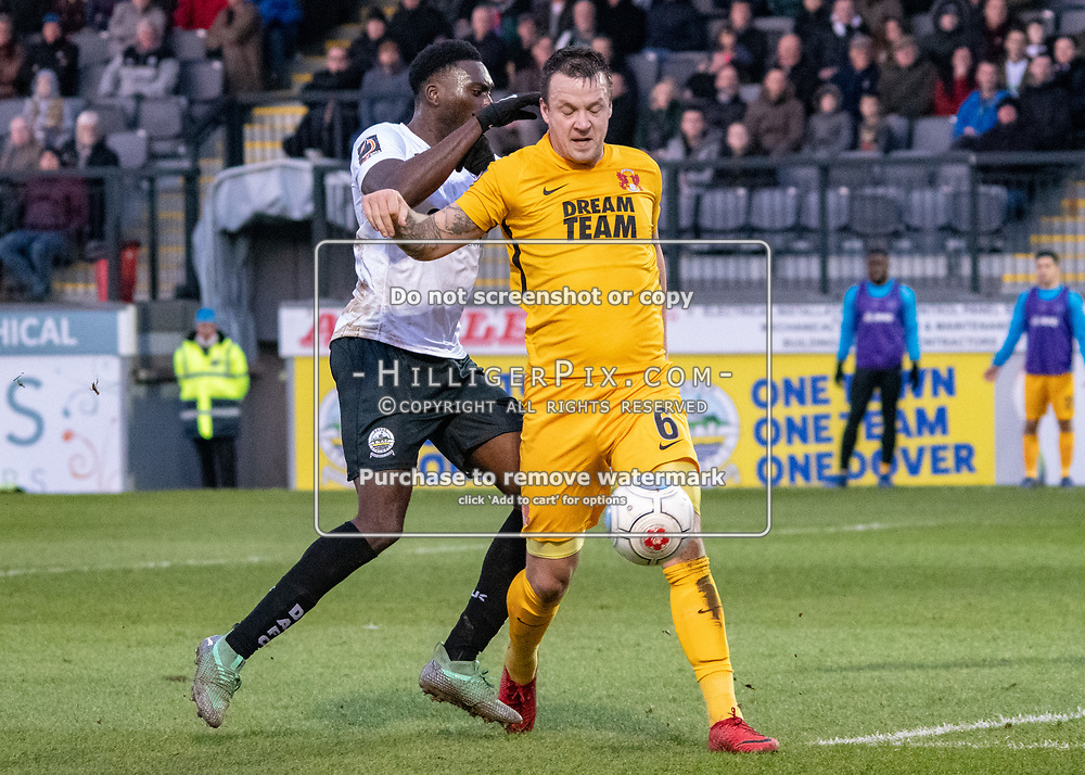 DOVER, UK - DECEMBER 29: Josh Coulson of Leyton Orient holds off the close marking during the Vanarama National League match between Dover Athletic and Leyton Orient at the Crabble Stadium on December 29, 2018 in Dover, UK. (Photo by Jon Hilliger)
