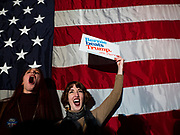 """31 DECEMBER 2019 - DES MOINES, IOWA: NATALIA A. SAULSKI, left, and BRIDGET ANN JOHNSTON cheer for Sen. Bernie Sanders during Sanders' """" Bernie's Big New Year's Bash,"""" a combination campaign rally/New Years Eve Party at the Marriott Hotel Downtown in Des Moines. Sen. Sanders is in Iowa campaigning to be the Democratic presidential nominee in 2020. Iowa hosts the first selection event of the presidential election cycle. The Iowa Caucuses are Feb. 3, 2020.     PHOTO BY JACK KURTZ"""