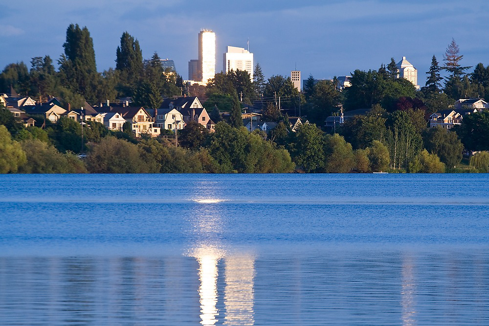 Downtown's skyscrapers appear to share the waterfront with large homes on the shores of Green Lake, a park in Seattle, Washington.