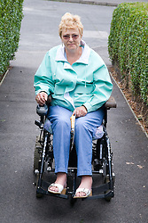 Woman wheelchair user in the street,