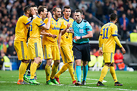 Juventus Giorgio Chiellini, Sami Khedira, Mario Mandzukic, Douglas Costa and Gianluigi Buffon protesting to referee during Champion League match between Real Madrid and Juventus at Santiago Bernabeu Stadium in Madrid, Spain. April 11, 2018. (ALTERPHOTOS/Borja B.Hojas)