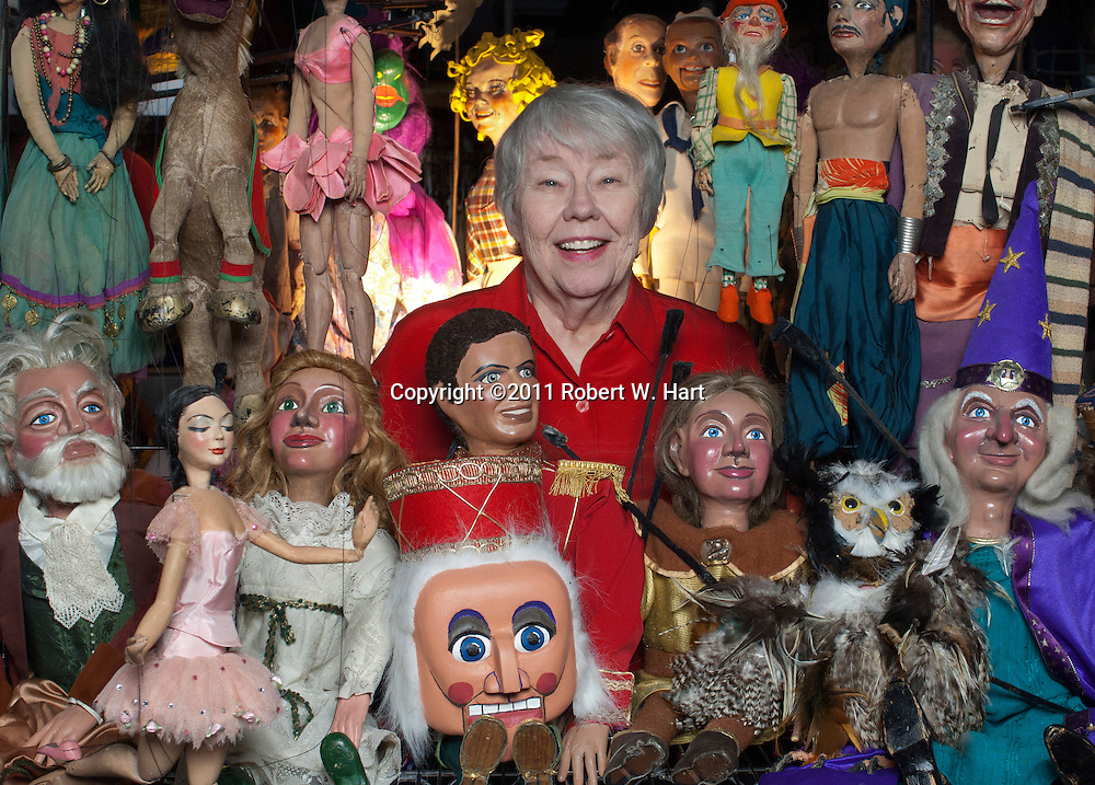 Kathy Burk surrounded by her puppets at The Dallas Children's Theater on 10/14/11....Robert W. Hart/Special Contributor