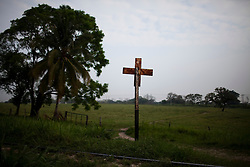 A railroad sign next to the train tracks in Tenosique, Tabasco.  Central American migrants  ride freight trains on these tracks that take them up to the border with the United States.  The trip for these migrants has become increasingly dangerous over the past several years as Mexico's drug war has raged and kidnappings and killings of migrants has increased.