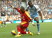 Photo: Paul Greenwood.<br />Man City v Reading. The Barclays Premiership. 03/02/2007. Reading's Leroy Lita (left) shields the ball from Micah Richards