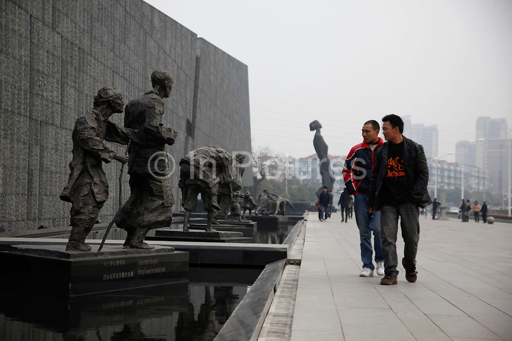 Visitors walk through the Nanjing Massacre Memorial in Nanjing, China on 04 March, 2011.  After seizing Shanghai in late 1937, the Japanese Army went on a six-week rampage in Nanjing, then known as Nanking, slaughtering and raping waves of civilians in an episode that later became known as the Nanking Massacre or the Rape of Nanking. Most historians generally agree that at least 150,000 people were killed in the massacre — China puts the death toll at 300,000 — and tens of thousands raped.